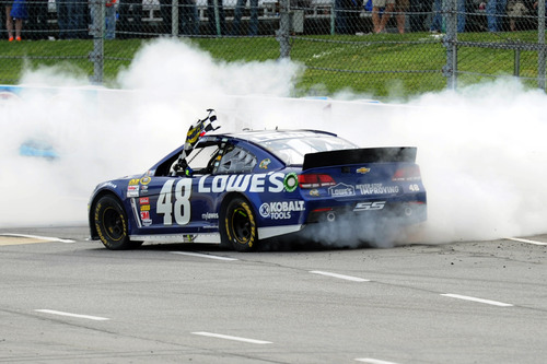 Jared C. Tilton | The Associated Press Jimmie Johnson (48) performs a burnout on the front stretch after winning the NASCAR Sprint Cup Series auto race, Sunday, April 7, 2013, at Martinsville Speedway in Martinsville, Va. (AP Photo/Jared C. Tilton, Pool)