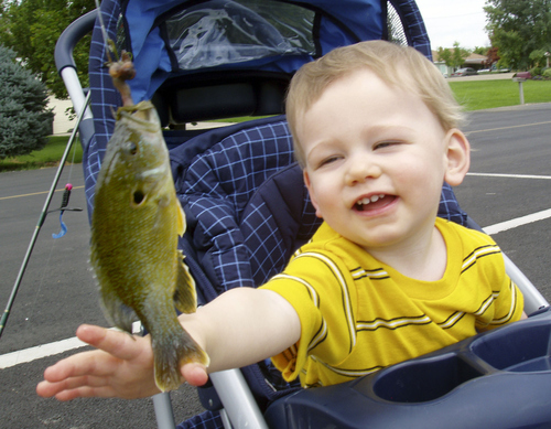 Jacob Myrup with a green sunfish on his very first fishing trip with his dad Kevin at Salem pond.