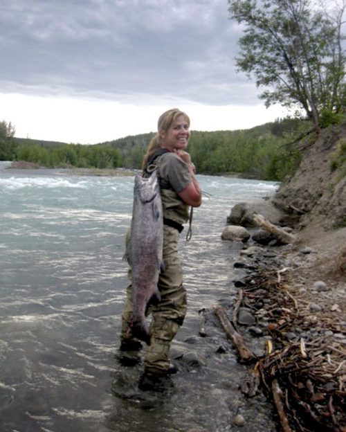 (Photo courtesy of Stew Webster)  Lisa Webster with a king salmon caught on the Klutina River in Alaska.