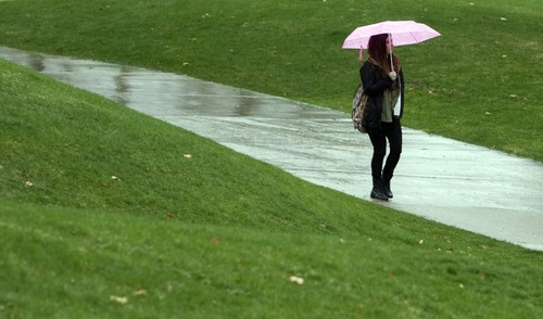 Kim Raff  |  The Salt Lake Tribune Madison Wilkins, a junior at the University of Utah, walks in the rain on campus in Salt Lake City on Monday April 8, 2013.