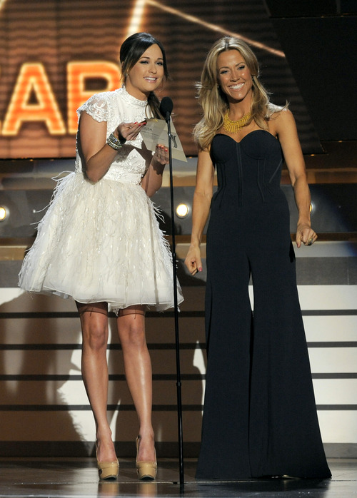 Singers Kacey Musgraves, left, and Sheryl Crow speak on stage at the 48th Annual Academy of Country Music Awards at the MGM Grand Garden Arena in Las Vegas on Sunday, April 7, 2013. (Photo by Chris Pizzello/Invision/AP)