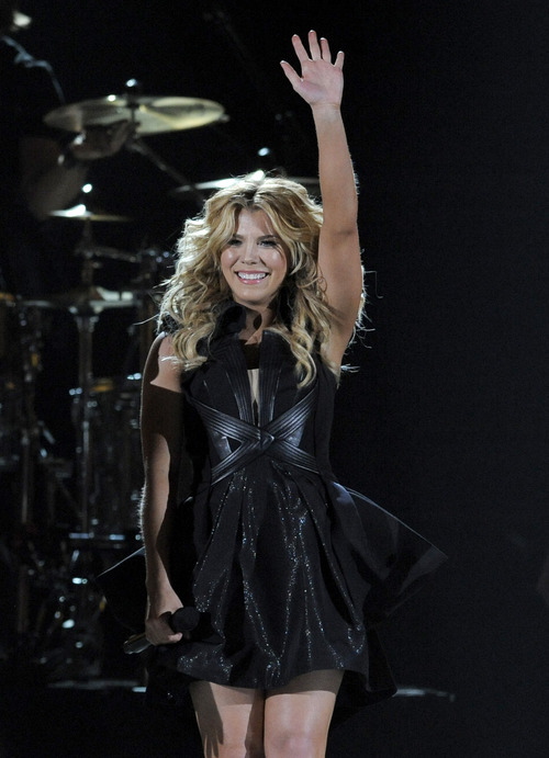 Kimberly Perry, of musical group The Band Perry, performs at the 48th Annual Academy of Country Music Awards at the MGM Grand Garden Arena in Las Vegas on Sunday, April 7, 2013. (Photo by Chris Pizzello/Invision/AP)