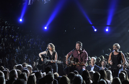 Blake Shelton, center, performs at the 48th Annual Academy of Country Music Awards at the MGM Grand Garden Arena in Las Vegas on Sunday, April 7, 2013. (Photo by Chris Pizzello/Invision/AP)