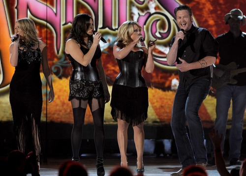From left, Ashley Monroe, Angaleena Presley and Miranda Lambert of musical group Pistol Annies, and singer Blake Shelton perform at the 48th Annual Academy of Country Music Awards at the MGM Grand Garden Arena in Las Vegas on Sunday, April 7, 2013. (Photo by Chris Pizzello/Invision/AP)