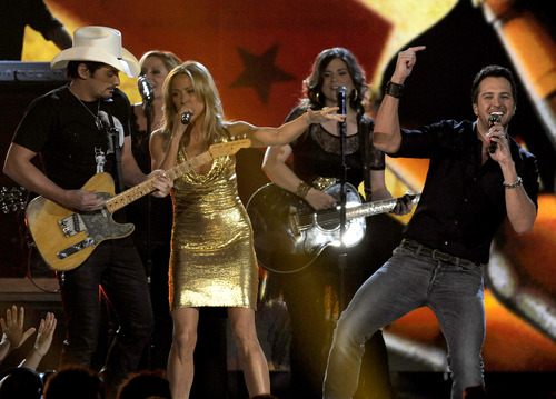 From left, musicians Brad Paisley, Cheryl Crow and Luke Bryan perform on stage at the 48th Annual Academy of Country Music Awards at the MGM Grand Garden Arena in Las Vegas on Sunday, April 7, 2013. (Photo by Chris Pizzello/Invision/AP)
