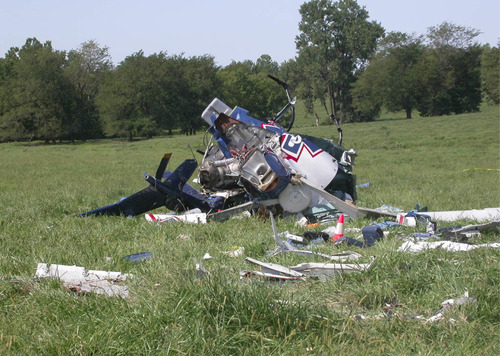 Courtesy of the National Transportation Safety Board This photo provided by the National Transportation Safety Board, shows the wreckage of a helicopter that crashed near Mosby, Mo., on Aug. 26, 2011. The pilot of an emergency medical helicopter may have been distracted by text messages when he failed to refuel his helicopter and misjudged how far he could fly before running out of fuel. The helicopter crashed, killing the pilot and three others on board. Government investigators are expected to point the case as another example of the distracting role cellphones and other electronic devices are playing in  transportation accidents.