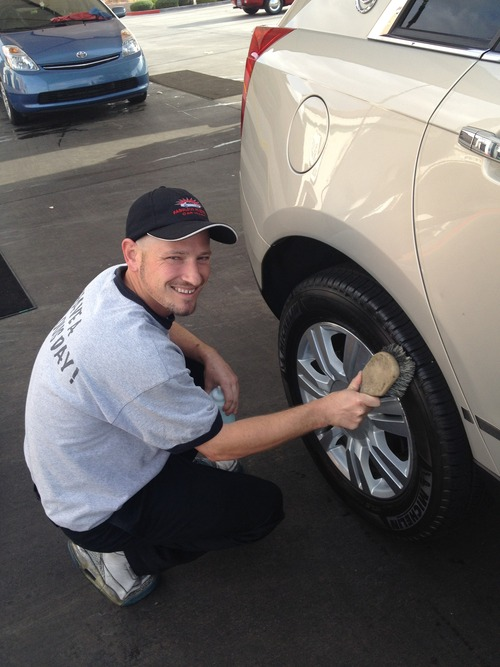 Courtesy | Fabulous Freddy's  An employee at the Durango location of Fabulous Freddy's dries a car wheel. The Sandy location, opening in late April, will hire between 100 and 150 employees to provide customers with full-service care.