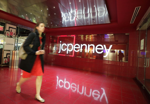A customer leaves a J.C. Penney store, Tuesday, April 9, 2013 in New York. J.C. Penney is hoping its former CEO can revive the retailer after a risky turnaround strategy backfired and led to massive losses and steep sales declines. The company's board of directors ousted CEO Ron Johnson after only 17 months on the job. The department store chain said that it has rehired Johnson's predecessor, Mike Ullman. (AP Photo/Mark Lennihan)