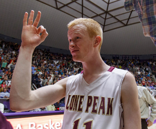 Trent Nelson  |  The Salt Lake Tribune Lone Peak's TJ Haws celebrates after beating Alta High School in the 5A basketball state championship game Saturday, March 2, 2013 in Ogden.