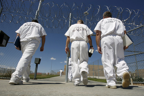 Inmates head back to their cells as he latest phase of expansion of a new wing at the Gunnison Prison is nearing completion with the use of state-allocated funds.  Photo by Francisco Kjolseth/The Salt Lake Tribune 8/18/2008