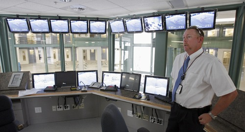 In this photo from 2008, Deputy Warden Shane Nelson at the Gunnison Prison discusses surveillance equipment. The mayor of Gunnison says the prison there has been an economic engine for the community.  Photo by Francisco Kjolseth/The Salt Lake Tribune