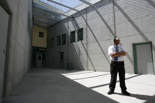 In this 2008 photo, Deputy Warden Shane Nelson with the Gunnison prison discusses the small couryards used by inmates. As Utah contemplates moving the Draper prison, the mayor of Gunnison says the prison there has helped the community economically.  Photo by Francisco Kjolseth/The Salt Lake Tribune