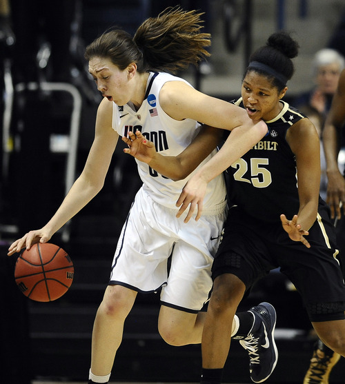 Connecticut's Breanna Stewart, left, drives past Vanderbilt's Morgan Batey in the first half of a second-round game in the women's NCAA college basketball tournament in Storrs, Conn., Monday, March 25, 2013. (AP Photo/Jessica Hill)