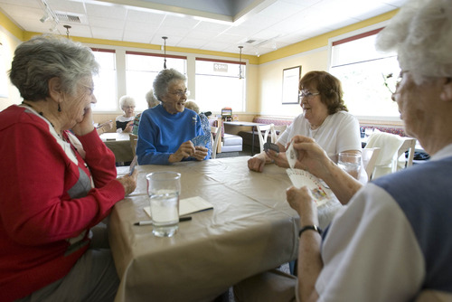 Paul Fraughton  | The Salt Lake Tribune Bridge players from left around the table, Leah Hilton, Gwen Leitch, Connie Adams and Lois Hollstein, talk and laugh as they play cards at the I-Hop on Highland Drive in Holladay.