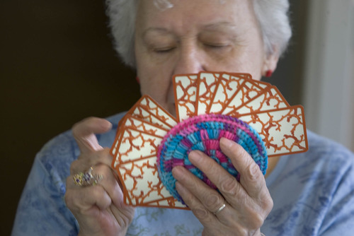 Paul Fraughton  |  The Salt Lake Tribune MarJean North uses her  hand made card holder as she organizes her cards.  Tuesday, April 2, 2013