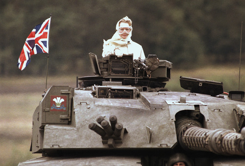 British Prime Minister Margaret Thatcher stands in a British tank during a visit to British forces in Fallingbostel, some 120km (70 miles) south of Hamburg, Germany, on Sept. 17, 1986. Thatcher's former spokesman, Tim Bell, said she died Monday morning, April 8, 2013, of a stroke. She was 87.(AP Photo/Jockel Fink)