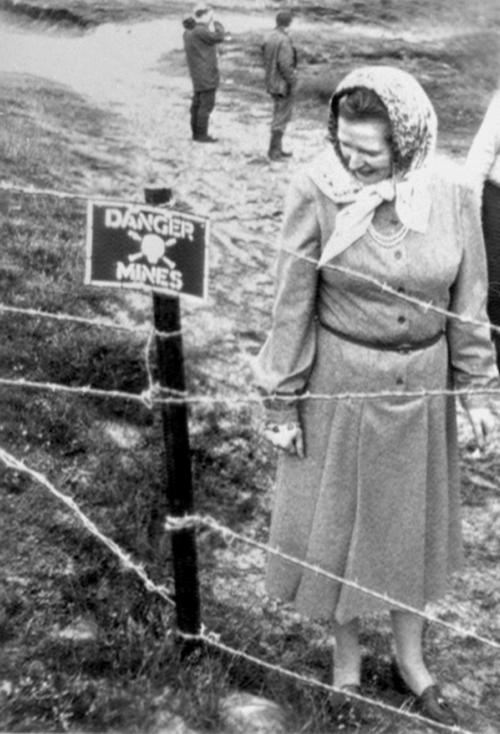 FILE - This is a March 10, 1983 file photo of former Prime Minister Margaret Thatcher examining a minefield during her visit to the Falkland Islands when the Royal Engineers took her on a tour of the Rookery Bay beach, a heavily mined area in the Falklands.  Thatcher's former spokesman, Tim Bell, said she died Monday April 8, 2013 of a stroke. She was 87.  (AP Photo/ PA/File) UNITED KINGDOM OUT NO SALES NO ARCHIVE