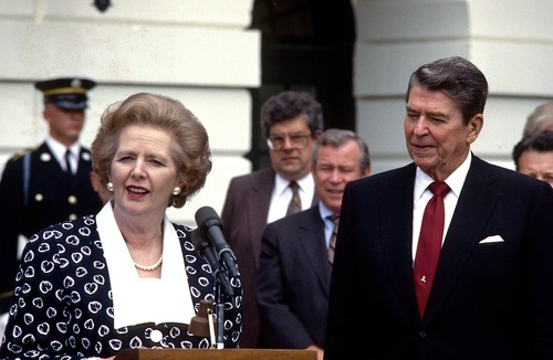 FILE - In a Friday, July 17, 1987 file photo, Prime Minister Margaret Thatcher of the United Kingdom, left, makes remarks after visiting United States President Ronald Reagan, right, at the White House in Washington, D.C. Thatcher's former spokesman, Tim Bell, said she died Monday morning, April 8, 2013, of a stroke. She was 87. (AP Photo/DPA, Howard L. Sachs, File)