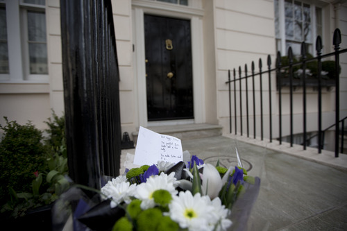 """A floral tribute is seen after being laid outside the home of the late former British Prime Minister Margaret Thatcher in London, Monday, April 8, 2013. Thatcher, the combative """"Iron Lady"""" who infuriated European allies, found a fellow believer in Ronald Reagan and transformed her country by a ruthless dedication to free markets in 11 bruising years as prime minister. She died Monday at age 87.  (AP Photo/Matt Dunham)"""