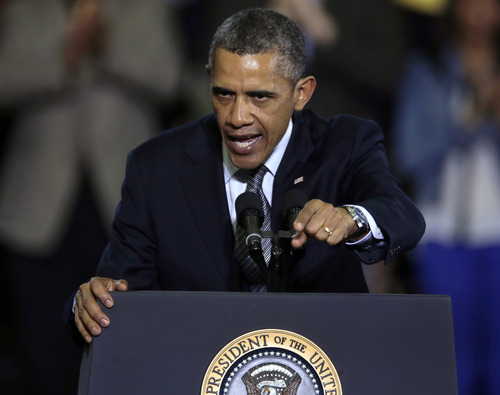 President Obama gestures during a visit to the University of Hartford, in Hartford, Conn., Monday, April 8, 2013. Obama visited the school to highlight gun control legislation and to meet with the families of victims from the Sandy Hook elementary school shootings.(AP Photo/Charles Krupa)