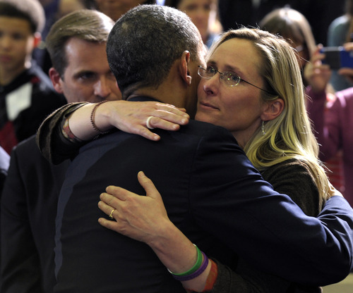 President Barack Obama hugs Newtown family member Scarlett Lewis, mother of shooting victim Jesse Lewis, after speaking at the University of Hartford in Hartford, Conn., Monday, April 8, 2013. Obama said that lawmakers have an obligation to the children killed and other victims of gun violence to act on his proposals.  (AP Photo/Susan Walsh)