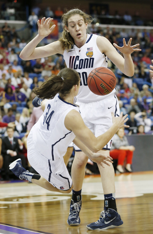 Connecticut guard Kelly Faris (34) dives for a loose ball as Breanna Stewart (30) reaches for it during the second half of the national championship game against Louisville at the women's Final Four of the NCAA college basketball tournament, Tuesday, April 9, 2013, in New Orleans. (AP Photo/Dave Martin)