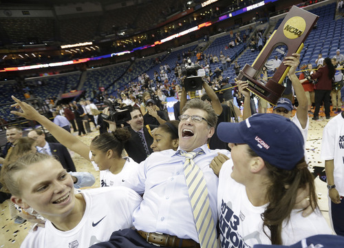 Connecticut players celebrate as they carry head coach Geno Auriemma off the court after defeating Louisville 93-60 in the national championship game of the women's Final Four of the NCAA college basketball tournament, Tuesday, April 9, 2013, in New Orleans. (AP Photo/Gerald Herbert)