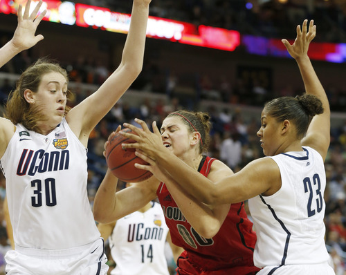 Louisville forward Sara Hammond (00) is defended by Connecticut forward Breanna Stewart (30) and Connecticut forward Kaleena Mosqueda-Lewis (23) during the second half of the national championship game of the women's Final Four of the NCAA college basketball tournament, Tuesday, April 9, 2013, in New Orleans. (AP Photo/Dave Martin)