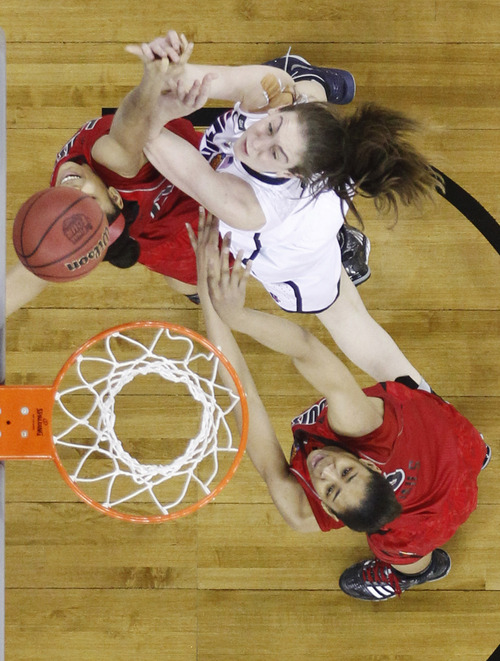 Connecticut forward Breanna Stewart (30) goes up for a shot against Louisville guard Bria Smith (21) and Louisville center Sheronne Vails (3) during the second half of the national championship game of the women's Final Four of the NCAA college basketball tournament, Tuesday, April 9, 2013, in New Orleans. (AP Photo/Gerald Herbert)