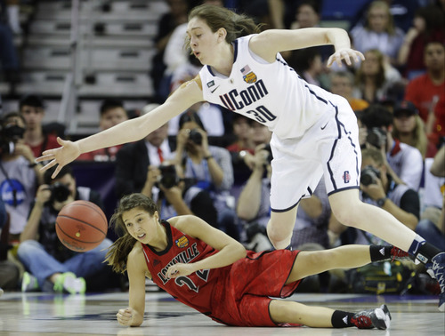 Connecticut forward Breanna Stewart (30) dives for a loose ball against Louisville guard Jude Schimmel (22) during the second half of the national championship game of the women's Final Four of the NCAA college basketball tournament, Tuesday, April 9, 2013, in New Orleans. (AP Photo/Gerald Herbert)