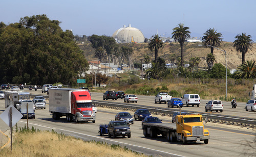 Lenny Ignelzi  |  The Associated Press In this Thursday, June 30, 2011 picture, a steady flow of traffic on Interstate 5 runs past the San Onofre Nuclear Generating Station in San Clemente, Calif. A new government report to be released Wednesday, April 10, 2013 challenges a pillar of planning for disasters at American nuclear power plants, finding that people living beyond the official 10-mile evacuation zone might be so frightened by the prospect of spreading radiation that they would flee of their own accord, clog roads, and delay the escape of others.