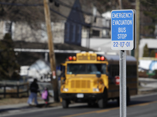 In this Thursday, Jan. 7, 2010 picture, a sign along Route 9 in Ossining, N.Y. marks the spot for an emergency bus stop that is part of the Indian Point nuclear plant evacuation plan. Nuclear sites were originally picked mainly in rural areas to lessen the impact of accidents. However, in a 2011 series, the AP reported population growth of up to 350 percent within 10 miles of nuclear sites between 1980 and 2010. About 120 million Americans - almost 40 percent - live within 50 miles of a nuclear power plant, according to the AP's analysis of Census data. (AP Photo/Julie Jacobson)