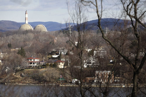 This Wednesday, Dec. 16, 2009 picture shows reactor containment domes of the Indian Point nuclear power plant in Buchanan, N.Y. above the homes just north of the town of Verplanck, N.Y. as seen from the Stony Point Historic Site, about 40 miles north of New York City. Nuclear sites were originally picked mainly in rural areas to lessen the impact of accidents. However, in a 2011 series, the AP reported population growth of up to 350 percent within 10 miles of nuclear sites between 1980 and 2010. About 120 million Americans - almost 40 percent - live within 50 miles of a nuclear power plant, according to the AP's analysis of Census data. (AP Photo/Julie Jacobson)
