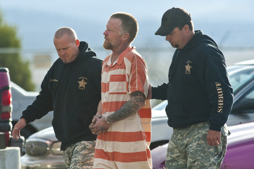 Chris Detrick  |  The Salt Lake Tribune Troy Knapp is escorted into the Sanpete County Sheriff's Office Tuesday April 2, 2013. The 45-year-old wilderness survivalist had frustrated law enforcement for more than five years as he continued to elude capture before surprising the group of antler hunters, who reported the sighting to police.