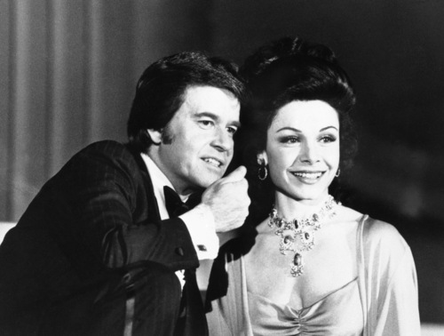 """FILE - In this January 1978 file photo, executive producer Dick Clark welcomes former """"Mouseketeer"""" Annette Funicello to the party when ABC-TV presents """"ABC's Silver Anniversary Celebration,"""" a gala four-hour telecast. Walt Disney Co. says, Monday, April 8, 2013, that Funicello, also known for her beach movies with Frankie Avalon, has died at age 70. (AP Photo/File)"""