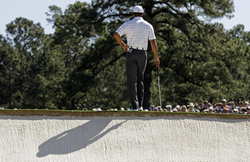 Tiger Woods waits to putt on the third green during the third round of the Masters golf tournament Saturday, April 7, 2012, in Augusta, Ga. (AP Photo/Charlie Riedel)