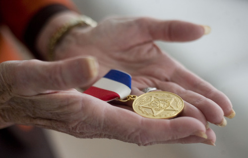 "Kim Raff  |  The Salt Lake Tribune Mary Gail Brassard was recently inducted in the Salt Lake Council of Women Hall of Fame.  She is photographed holding the ""Medal of Freedom"" award, that was given to her by President George W. Bush in 2003, in her home in Salt Lake City on April 8, 2013."