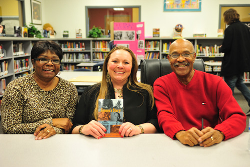 Courtesy | Cassie Cox Annie Wright, left, English teacher Cassie Cox and author Simeon Wright pose with his book Simeon's Story during his visit to Two Rivers Alternative High School in Ogden, Utah.