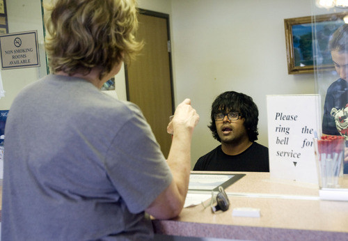 Kim Raff  |  The Salt Lake Tribune Kunal Sah books a room for a customer while working the front desk of the Ramada Inn in Green River on March 28, 2013. Sah is 19 years old and runs the Ramada Inn for his parents, Ken and Sarita Sah, who returned to India after losing a battle with Immigration seven years ago.