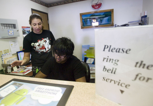 Kim Raff  |  The Salt Lake Tribune Kunal Sah works the front desk of the Ramada Inn with his girlfriend, Cassandra Hawkinson, in Green River on March 28, 2013. Sah is 19 years old and runs the Ramada Inn for his parents, Ken and Sarita Sah, who returned to India after losing a battle with Immigration seven years ago. Hawkinson joined Sah to help out at the hotel four months ago after Sah began to experience debilitating headaches.