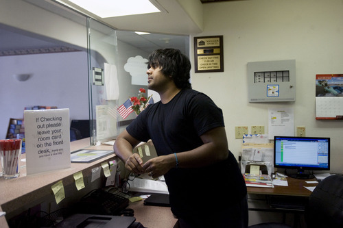 Kim Raff  |  The Salt Lake Tribune Kunal Sah works the front desk of the Ramada Inn in Green River on March 28, 2013. Sah is 19 years old and runs the Ramada Inn in Green River, Utah for his parents, Ken and Sarita Sah, who returned to India after losing a battle with immigration officials seven years ago.