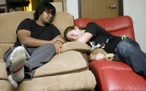 Kim Raff  |  The Salt Lake Tribune Kunal Sah and his girlfriend, Cassandra Hawkinson, hang out in their apartment at the Ramada Inn in Green River on March 28, 2013, with Cassandra's mother's dog, Bella. Sah is 19 years old and runs the Ramada Inn in Green River, Utah for his parents, Ken and Sarita Sah, who returned to India after losing a battle with immigration officials seven years ago. Hawkinson joined Sah to help out at the hotel four months ago after Sah begun to experience debilitating headaches.