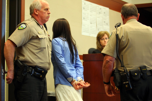 Jamie Waite is taken into custody following her sentencing Friday, April 12, 2013 at 2nd District Court in Ogden. (Nick Short photo)
