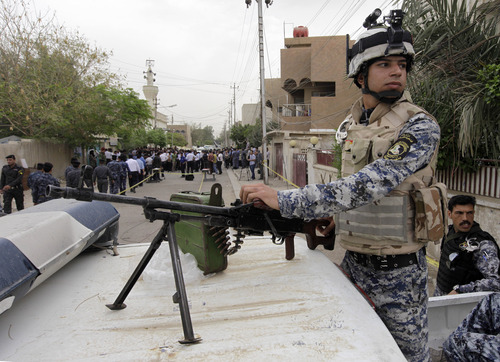 Iraqi federal policemen guard a polling center in the early voting for police and army and security forces in Baghdad, Iraq, Saturday, April 13, 2013. Voters head to the polls next week for the first time since the U.S. military withdrawal, marking a key test for Prime Minister Nouri al-Maliki's political bloc and for the security forces under his command that are charged with keeping voters safe. (AP Photo/ Khalid Mohammed)