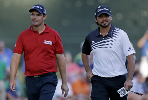 Padraig Harrington, left, of Ireland, and Jason Day, of Australia, walk up the 16th fairway during the second round of the Masters golf tournament Friday, April 12, 2013, in Augusta, Ga. (AP Photo/David Goldman)