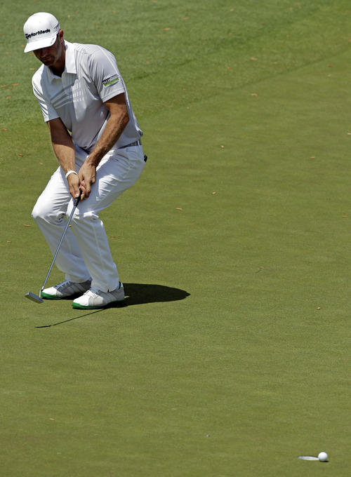 Dustin Johnson misses a putt on the 15th green for a double bogie on the hole during the second round of the Masters golf tournament Friday, April 12, 2013, in Augusta, Ga. (AP Photo/Charlie Riedel)