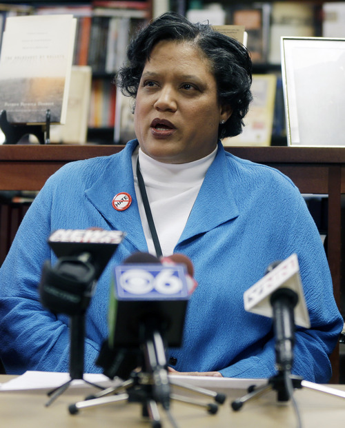 Albany Public Schools Superintendent Marguerite Vanden Wyngaard speaks about a Nazi-themed assignment given to students during a news conference on Friday, April 12, 2013, in Albany, N.Y. Vanden Wyngaard said a high school English teacher could face disciplinary action for giving the writing assignment that asked students to make a persuasive argument blaming Jews for the problems of Nazi Germany. (AP Photo/Mike Groll)