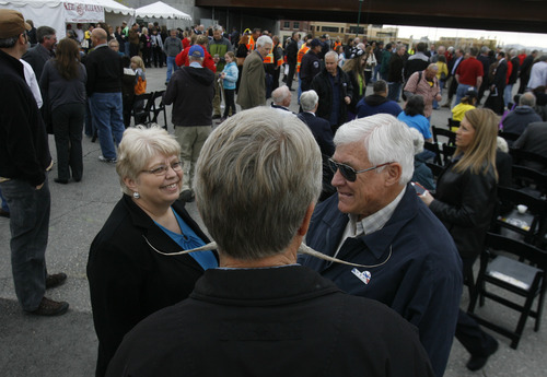 """Scott Sommerdorf      The Salt Lake Tribune Murray Mayor Dan Snarr and his famous moustache holds court at the """"Food is Your Fare"""" event at North Temple Bridge Station, Saturday, April 13, 2013. One could donate a can of food to ride the new Airport Line before it opens service to Salt Lake City International Airport."""
