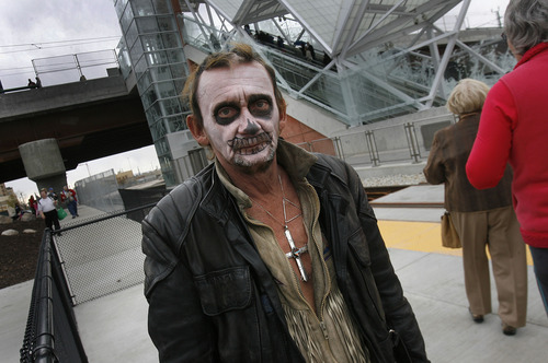"""Scott Sommerdorf      The Salt Lake Tribune People attending the """"Food is Your Fare"""" event could get face paint at local food and drink at the ceremony near North Temple Bridge Station,  Saturday, April 13, 2013."""
