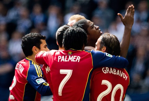 Real Salt Lake's Olmes Garcia, centre right, of Colombia, is mobbed by his teammates after scoring a goal against the Vancouver Whitecaps during the second half of an MLS soccer game in Vancouver, British Columbia, on Saturday April 13, 2013. (AP Photo/The Canadian Press, Darryl Dyck)